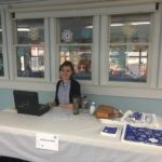 Our very own Emily Wood working the front desk at the holiday boutique!