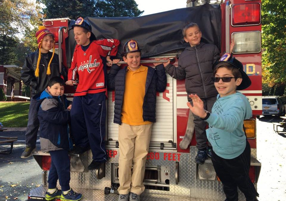 Our Students Posing on the Fire Truck having a great time!